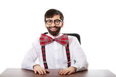 Young old fashioned man sitting by a desk. Stock Photo