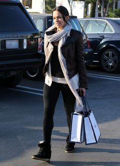 Fast and the Furious star Michelle Rodriguez managed to crack a smile while leaving Fred Segal in Beverly Hills, California on December 7, 2012.