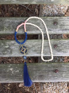 A personal favorite from my Etsy shop https://www.etsy.com/listing/468172102/46-navy-blue-white-pink-and-gold-bead
