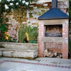 Rustic brick wall and fireplace...would love this in my back yard!