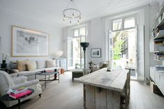 A small London flat that lives large.  Design does work in a large one-room space!
