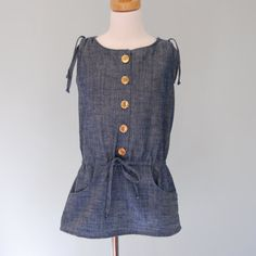 Girls tunic made of cotton chambray - girls drawstring tunic with gold buttons - girls tunic 6 to 11 years. $43.00, via Etsy.
