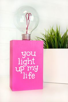 DIY Valentine's Day Lightbulb Gift-I have seen a lot of cool recycled lightbulb crafts recently and was inspired to use some of my dead light bulbs to create this cute DIY Valentine's Day lightbulb gift! Here is how you can make your own.