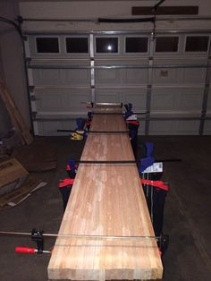 Great stuff although I would change two things. First, the legs need to be further apart (adding a third one is probably best) and secondly the box doesn't need to be so high that the board sits in. Just a couple inches different.   DIY Shuffleboard Table - Imgur