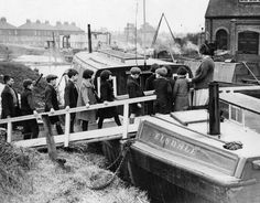 """Caption: """"3rd February 1936: Children of canal boatmen arrive for lessons at the barge school at West Drayton, Middlesex. The school is under the control of Middlesex Education Committee and is the only school on a barge in Britain."""""""