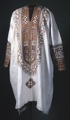 Africa: Ethiopia  |  Cotton tunic embroidered with silk thread. The tunic is embroidered with bands of designs around the neck opening and the length of the sleeves.  |  Acquisition details unknown