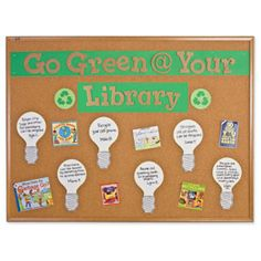 "For Earth Day: ""Go Green @ Your Library"" text surrounded by a display of relevant books in the collection."