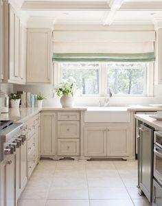 Shades of white in the Silestone quartz countertops, Walker Zanger backsplash tile, Kohler apron-front sink and Florida Tile ceramic floors enhance the room's airy appearance.