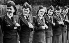 Luftwaffehelferinnen showing their id tags. Never seen a photo with the girls wearing them before!