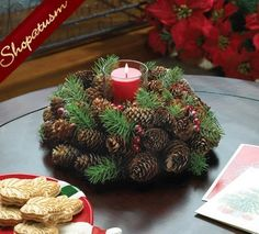 Dress up your holiday table with this merry pine cone wreath candle holder. Sprigs of pine branches, pine cones, and red berries wrap around a clear glass cup that's ready for the candle of your choic Holiday Candles, Christmas Centerpieces, Christmas Decorations, Christmas Ornaments, Pine Cone Decorations, Decoration Table, Pine Cone Crafts, Holiday Crafts, Natal Natural