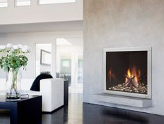 A fireplace from California Mantel & Fireplace, Inc. adds a stunning finish to any space. #luxeSoCal
