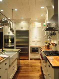Love!!! I want that farmhouse sink & butcher block counter tops!!