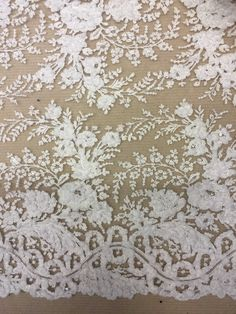 A new lace that will be in stock from April 2017. Better photos coming soon! LISTING IS FOR 1 YARD! WE CAN GET AS MANY YARDS AS YOU NEED! We are the go to source for designers and dressmakers looking to add a unique touch to their stunning creations. With bridal and event fashion always changing, it can be a challenge creating a look that is uniquely you. Our lace, fabric, trims and appliqués are embroidered into intricate designs using the finest beading and crystals. Sold by the yard or…