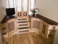 narrowboat interior from http://cumbrianarrowboats.co.uk.  This along with a central island housing a hob and sink.  Perfect!