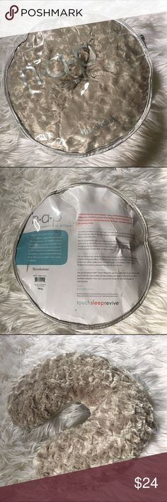 Brookstone NAP U Dream Travel Pillow - NWT NWT NAP Dream U Pillow by Brookstone. Beige color, super soft furry feel with beanie movable pellets inside that contour your neck when resting during travel!! Never used! Original package and still has tags attached. brookstone Other