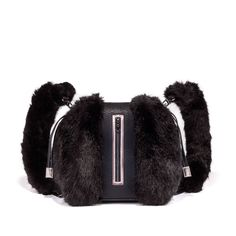 KULU black. Multiuse: a backpack / a shoulder bag with adjustable shoulder straps. Made of luscious faux exotic skins and faux fur #NeverLeather #NeverFur