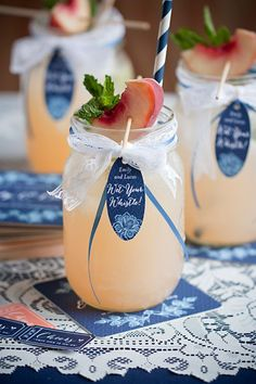 Wrap mason jars with lace and ribbon, then add paper straws for DIY welcome drinks. Wedding Colors: Navy Blue and Peach