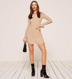 This is a high neck, fit and flare dress with a removable belt, a ruffled neckline and bell sleeves.  #dress #dresses #fashion #fitandflare #style #minidress #taupe #beige #neutral #ad