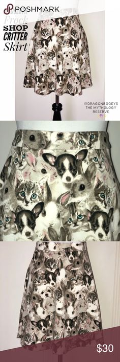 """ModCloth Frock Shop Critter Skirt Absolutely adorable circle skater skirt printed with fluffy gray and white bunnies with pink ears, white and black fuzzy puppies, and kittens with striped heads and bright blue eyes. There might even be a chinchilla in there! Side zipper closure. Fabric is 85% polyester and 15% spandex. Length is 19"""", waist is 15.5"""" laid flat. Material does give a little bit of stretch. Brand new with tags. Modcloth Skirts Circle & Skater"""