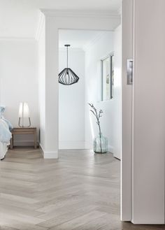 Pale grey parquet wood floor in a bedroom