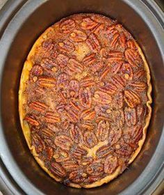 Crockpot Pecan Pie 1 uncooked piecrust  3 eggs  1 cup sugar  2/3 cup dark Karo syrup  1 cup pecans, broken up  1/2 cup margarine, melted  1 teaspoon vanilla  Spray the slow cooker with nonstick cooking spray.  Place uncooked piecrust in the slow cooker and press up the edges about 1/2 inch up the sides.  In a medium-mixing bowl, stir the remaining ingredients until well mixed. Pour on top of the piecrust. Cover and cook on High for 2-3 hours.