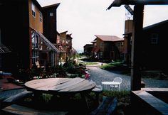 The Ecovillage at Ithaca, in the late afternoon. Photo taken in 1998 when the Ecovillages first neighbourhood was nearing completion. Its a good example of a neighbourhood that puts healthy living before pavement and driveways. Parking is immediately adjacent, and there are easy systems to get groceries, deliveries, etc., in and out. But gracefully, this is place one place that isn't defined by cars.