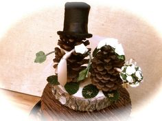 rustic wedding cake topper pine cone forest fall country winter decorations. $35.00, via Etsy.