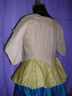 1765 woman's bodice - Ivory silk faille with jewel-tone florals, attached peplum with accordion pleats at back sides. Faux pockets - inte...