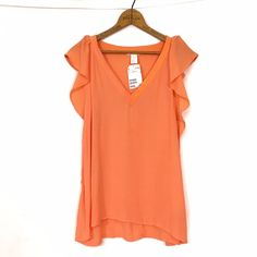 "H&M bright flutter ruffle sleeveless top New, unworn condition; tags attached. Color is best shown in photo one with actual garment being slightly brighter. 100% viscose. Bust 38"" length 24"" H&M Tops Tank Tops"