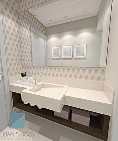 Lavabo com espelho bisotado e papel de parede com efeito 3D