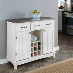 Increase your storage with this Home Styles larger server buffet with natural wood top. Add kitchen storage space without sacrificing style with a Home Styles buffet. Kitchen Buffet Cabinet, Wood Buffet, Sideboard Cabinet, Kitchen Dining, Dining Room, Cabinet Doors, Kitchen Decor, Dining Area, Sideboard Ideas