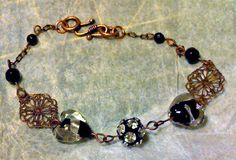 Love the combo of copper and black! Black and silver lampwork glass hearts by rowdylady on Etsy, $15.00
