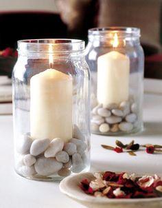 con piedras de rio y velas