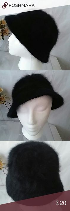 BeBe Black Angora Blend Bucket Hat Very soft classy looking hat.  The hat is in good condition, is 50% angora 30% wool 20% nylon.  bebe is embroidered on the front of the hat.  One Size Fits Most bebe Accessories Hats