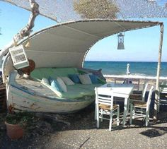 Fun boat lounge located at SeaSide, a restaurant in Santorini Greece