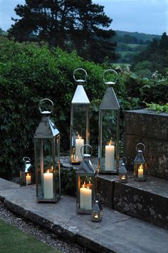 different size lanterns for the pergola steps to make it to an alter but needs to add flower petals or greens and flowers
