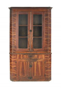 "Realized Price: $1458   Pennsylvania painted pine two-piece corner cupboard, 19th c., retaining its original flame grained surface, 88 1/2"" h., 48 1/2"" w."