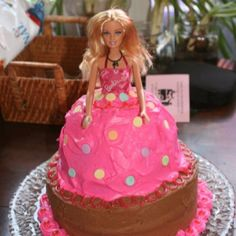 My daughter made this adorable Barbie cake by baking the skirt in a stainless steel mixing bowl and inverting over a regular layer cake. She inserted the Barbie and decorated the cake. My granddaughter loved it for her fifth birthday.