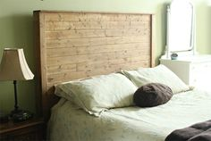 This weathered, rustic headboard is made with recycled wood.  Good for your style and the environment.