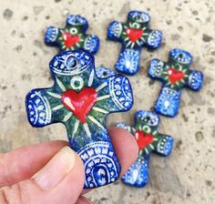 Mexican Folk Art Crosses, 6 Handmade Sacred Heart Cross Pendants by PendantDestash on Etsy https://www.etsy.com/listing/523277844/mexican-folk-art-crosses-6-handmade