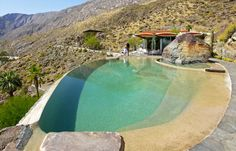 this shore-inspired pool sits on a hillside overlooking Palm Springs and is accompanied by a boulder-side hot tub