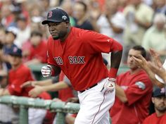 Boston Red Sox designated hitter David Ortiz runs out of the dugout as fans and teammates applaud during a ceremony recognizing his 400th career home run, prior to the Red Sox's baseball game against the New York Yankees at Fenway Park in Boston on Friday, July 6, 2012. (AP Photo/Elise Amendola)