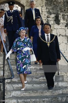 Queen Elizabeth II, wearing a blue multi-coloured dress designed by John Anderson, and a hat by milliner Philip Somerville, on a walkabout with local diginitaries during a visit to Cyprus, 21 October 1993. The Queen is on an official visit to Cyprus, in her capacity as Head of the Commonwealth, to attend the 13th Commonwealth Heads of Government Meeting.