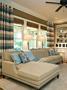 Love the drapes and pillows!  Classic & Simple Family Room | Rebecca Driggs | HGTV