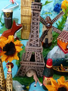 Sara Drake - France detail from large 3D world map. Maps are made from mixed media, including papier mache, balsa wood, acrylic paint, beads and wire. All details are hand made and to commission. Each map is personalised with the details of the client's own travels.