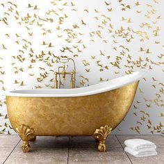 We're loving this Flock Of Cranes Stencil from Cutting Edge Stencils! Unique way to give your bathroom a customized look, and a perfect accent behind the claw foot tub!