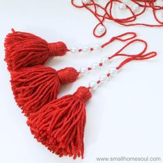 Beautiful Christmas Tassel Ornaments are quick to make and customize with fun beads. : Beautiful Christmas Tassel Ornaments are quick to make and customize with fun beads. Homemade Christmas, Simple Christmas, Christmas Diy, Beautiful Christmas, Christmas Stuff, Retro Christmas, Diy Yarn Ornaments, Handmade Ornaments, Glitter Ornaments