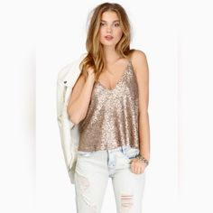 Gold Sequin Shana Top Matte gold sequin covered tank top with spaghetti straps. Slight flare. This is NWT because I didn't like the way it fit me. Perfect for New Years! Tobi Tops Tank Tops