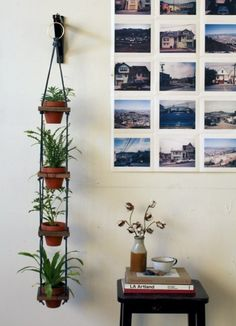 An interesting tiered hanging plant hanger can make for unique wall decor.