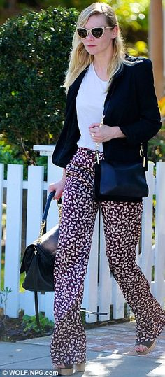 7f3bb781b0 Kirsten Dunst steps out in cat s eyes sunglasses and funky animal print  trousers